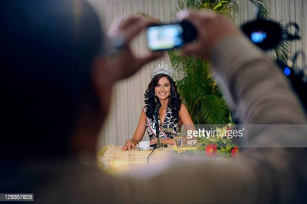 A person takes a picture of new Miss Venezuela 2011 Irene Esser during a press conference in Caracas on October 16 2011 Esser won Miss Venezuela...