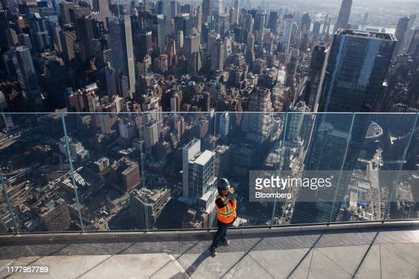 A person takes a selfie on the Edge observation deck at 30 Hudson Yards during a media preview event in New York US on Thursday Oct 24 2019 Edge is...