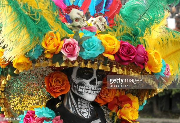 TOPSHOT A person takes part in the Day of the Dead parade in Mexico City on October 27 2018