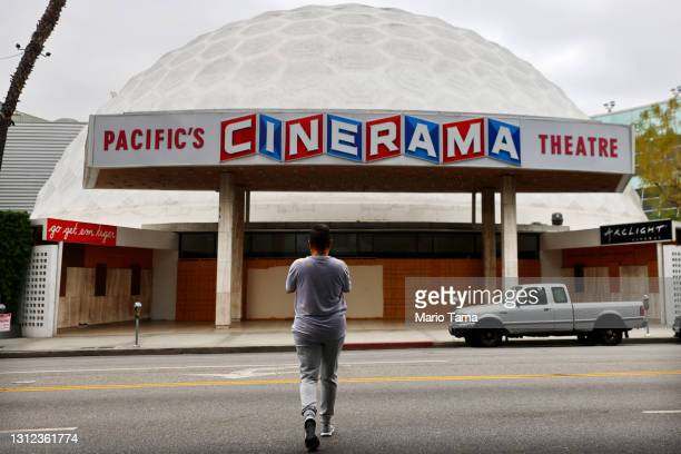 Person takes photos of the famed Cinerama Dome at the shuttered ArcLight Hollywood movie theater on April 13, 2021 in Los Angeles, California....