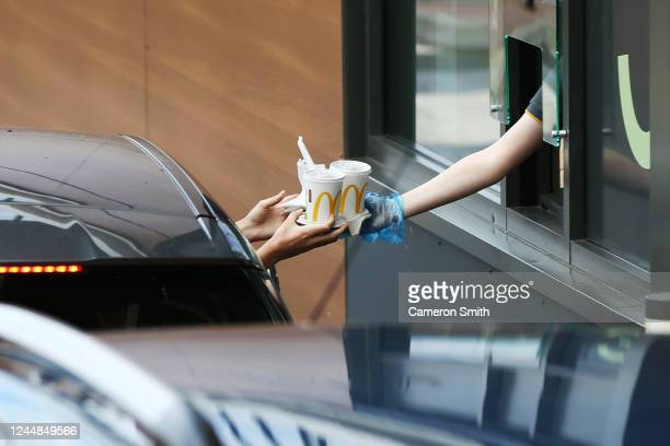 Person takes their food at a Drive Thru McDonald's on June 04, 2020 in Stourbridge, England. The British government further relaxed Covid-19...