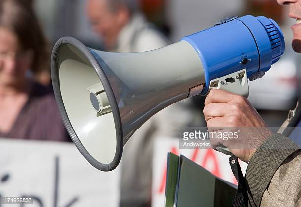 person talking in a blow horn at a demonstration - trade union stock pictures, royalty-free photos & images