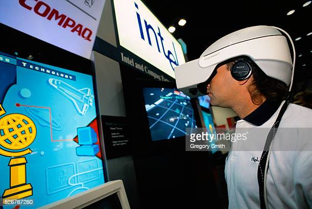 A person tests a virtual reality program at the Compaq Worldwide Technology Summit in Houston Texas The virtual reality unit uses a Compaq pentium...