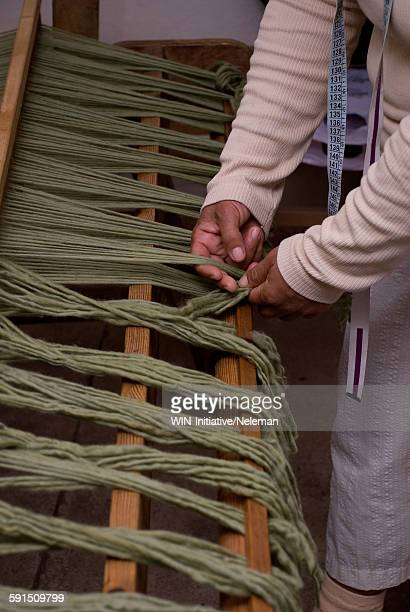 Person threading for the weaving process