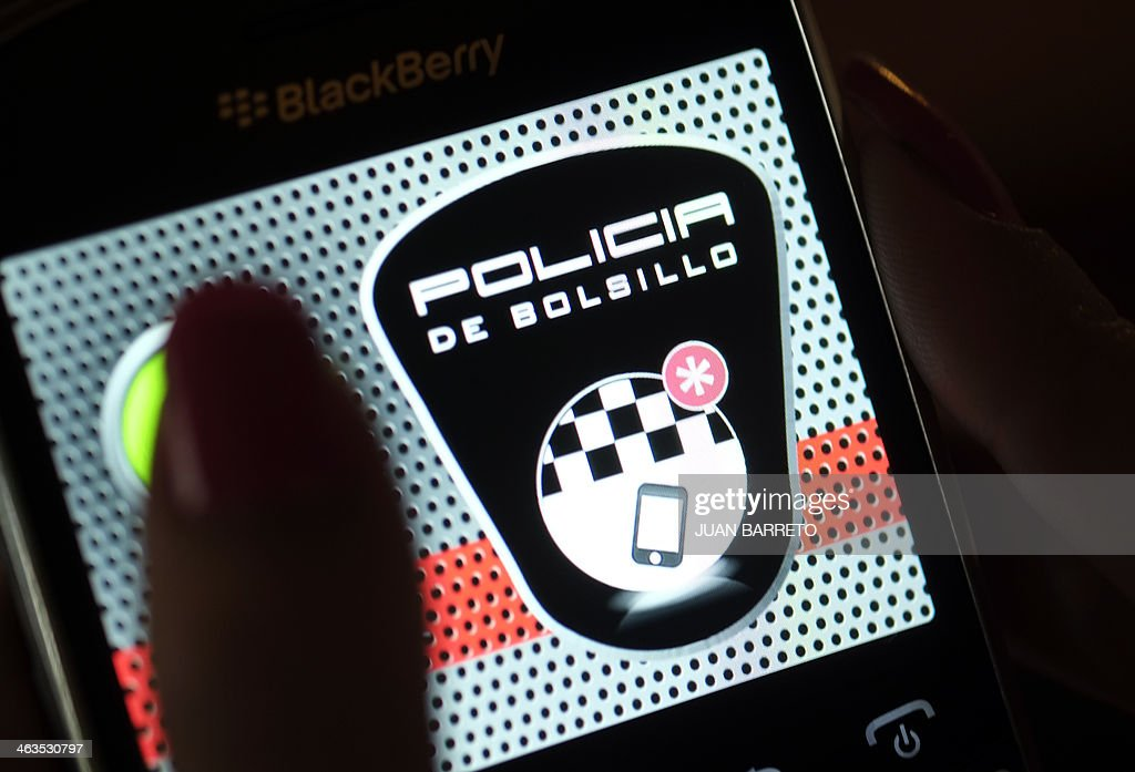 A person touches a cell phone app called Pocket Police in Caracas on January 18, 2014. A free app for certain smartphones that works as a 'panic button' in emergencies has been launched in Venezuela, one of the world's most violent countries, a lawmaker said Saturday.