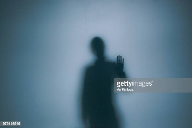 person touching window - loneliness stock pictures, royalty-free photos & images