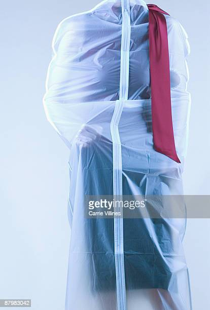person trapped inside garment bag - body bag stock photos and pictures