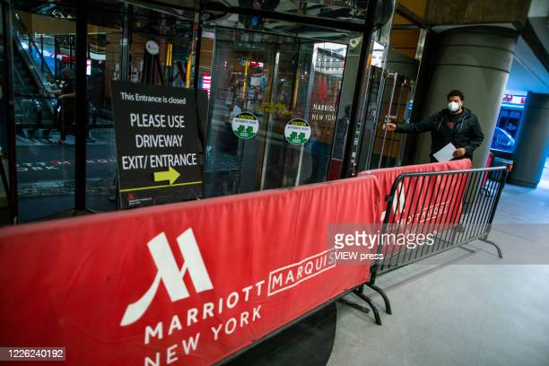 A person try to go inside of one of the entrance of the International Hotel Marriott Marquis while it's closed during the outbreak of the COVID19...