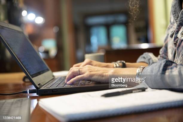 Person uses a laptop computer while working from home in an arranged photograph taken in Tiskilwa, Illinois, U.S., on Tuesday, Sept. 8, 2020....