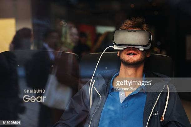 A person uses a Samsung virtual reality headset at the company's new store in lower Manhattan on October 11 2016 in New York City Less than two...