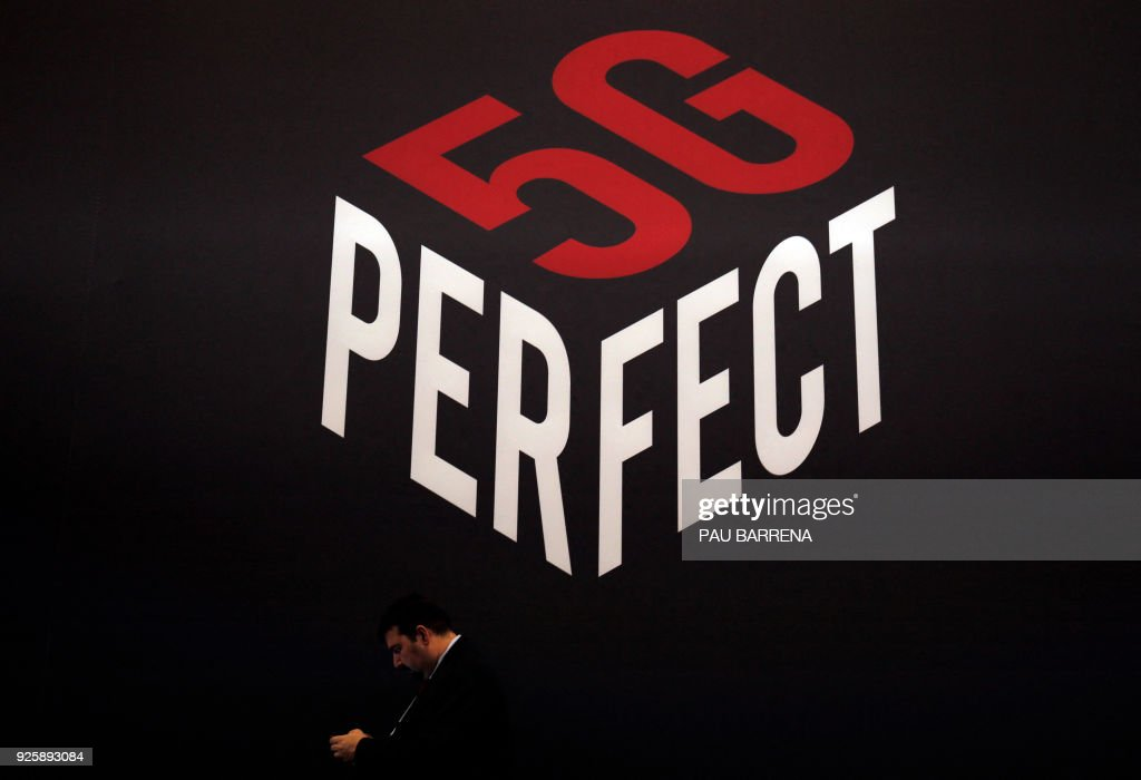 A person uses a smartphone under a 5G Perfect logo at the