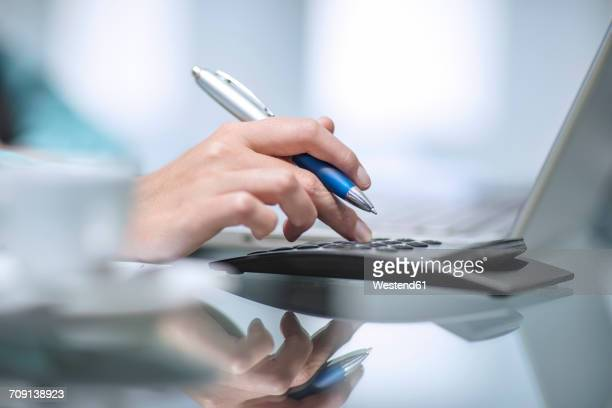 person using calulator - accounting stock photos and pictures