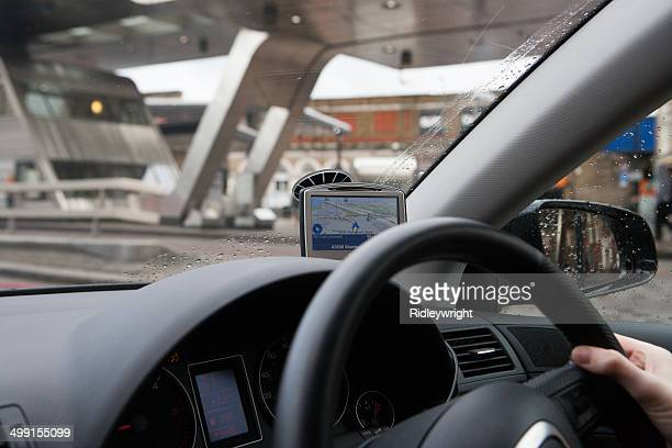 Person using car global positioning system to navigate city