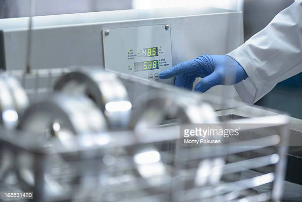 Person using control panel.  Cleaning engineering products using ultrasonics