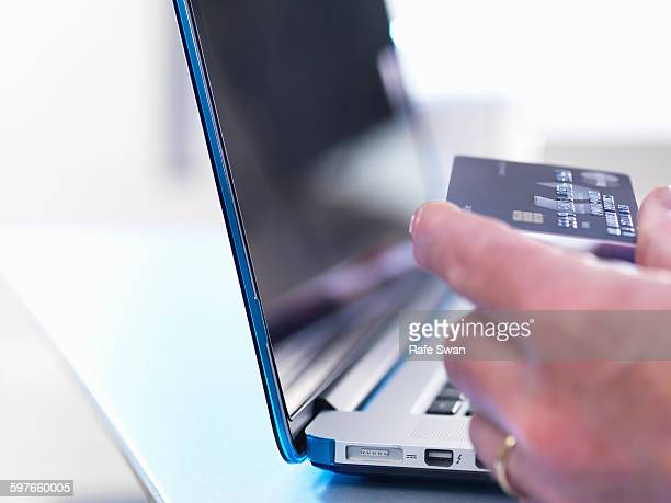 Person using credit card to buy online