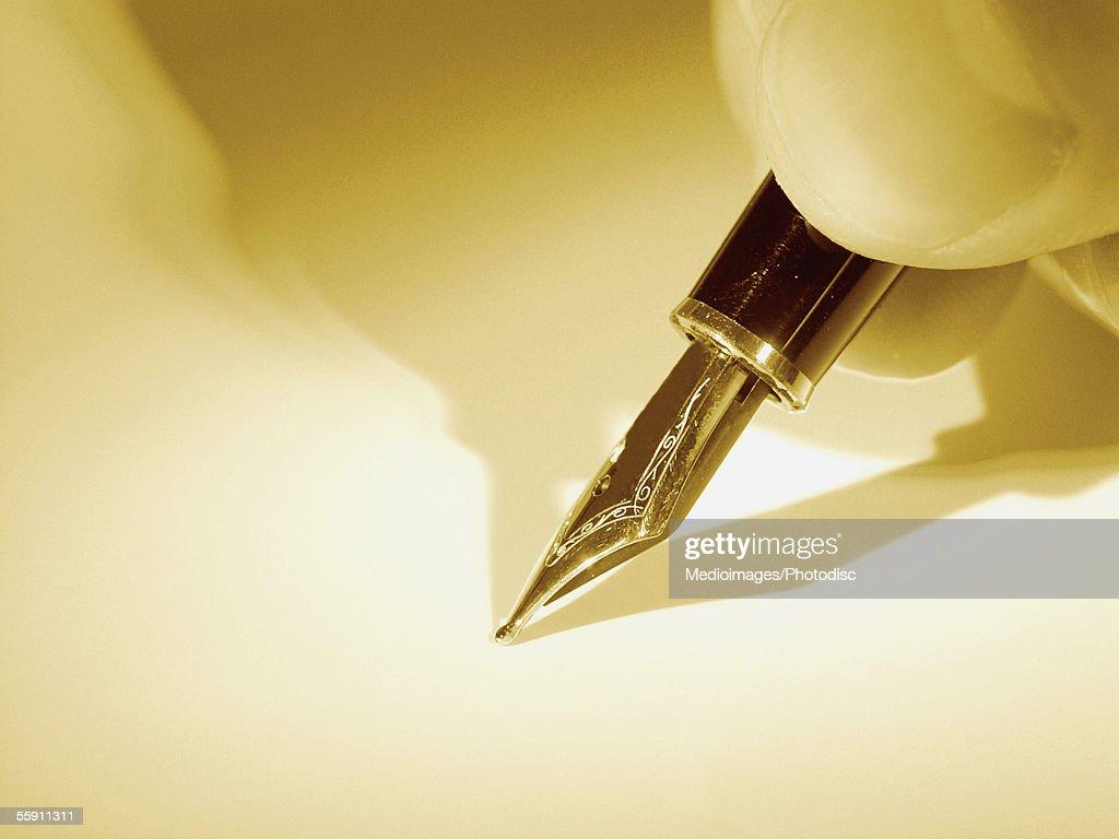 Person using fountain pen : Stock Photo