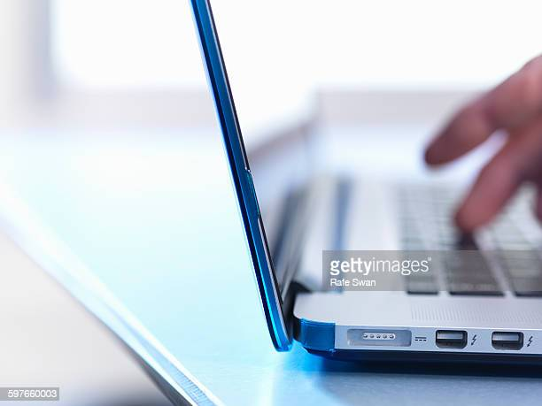 Person using laptop, close up