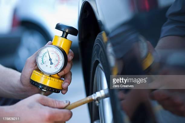 Person using pressure gauge
