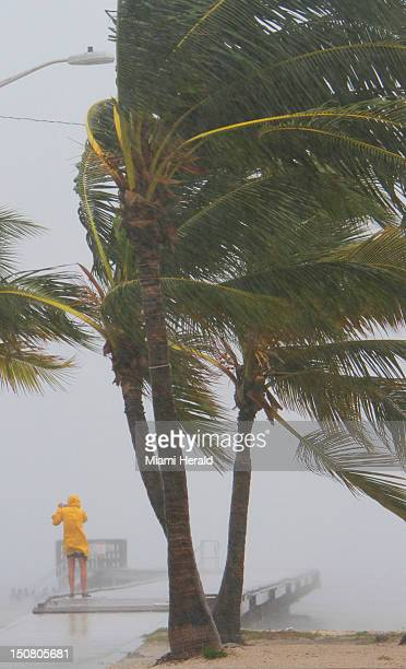 A person ventures out into the storm at Clarence Higgs Beach this afternoon as Tropical Storm Isaac hits Key West Florida on Sunday August 26 2012