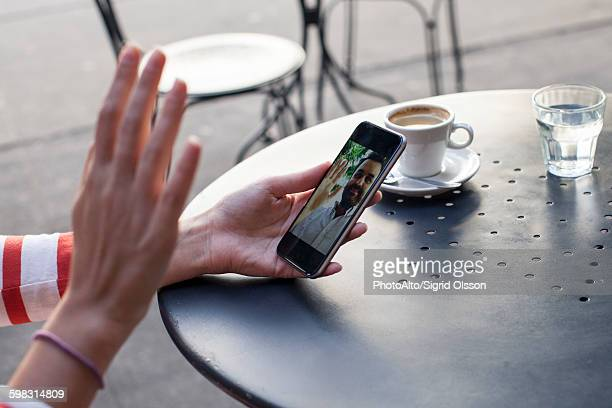 person video chatting with a smartphone, cropped - long distance relationship stock pictures, royalty-free photos & images