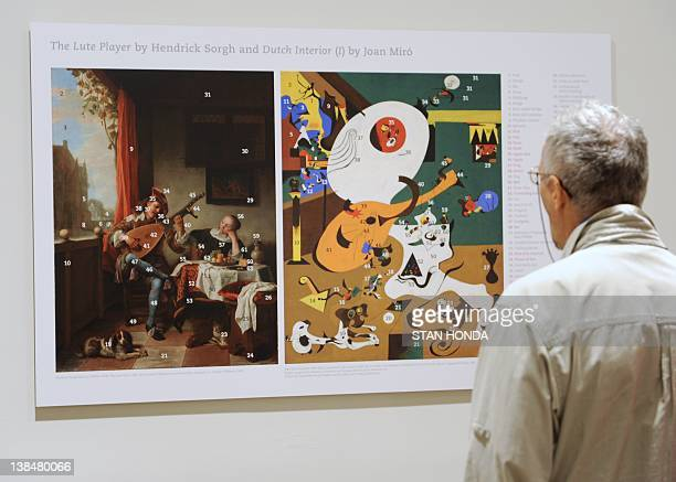 A person views a comparison of The Lute Player by Hendrick Sorgh and Catalan painter Joan Miró's Dutch Interior I Summer 1928 in the exhibition Miro...