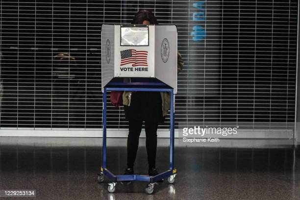 A person votes at the Barclays Center during early voting for the US Presidential election on October 24 2020 in the Brooklyn borough in New York...