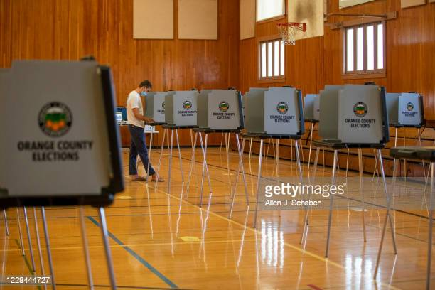 Person votes at the Huntington Beach City Gym and Pool on election day Tuesday, Nov. 3, 2020 in Huntington Beach, CA.