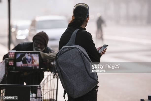 A person waits for a ride share car outside Twitter Inc headquarters in San Francisco California US on Thursday Nov 15 2018 Most tech stocks have...