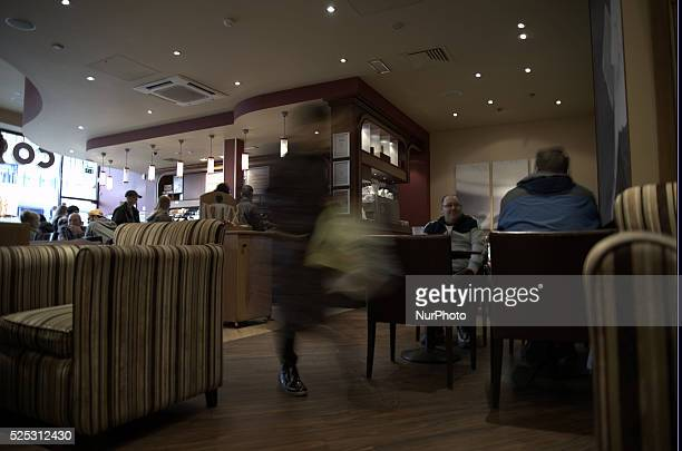 A person walking through a Costa Coffee shop in Stockport on Monday 2nd March 2015