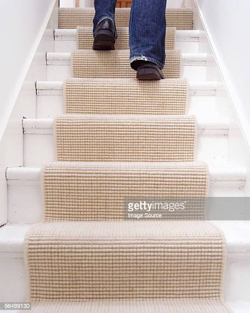 A person walking up the stairs