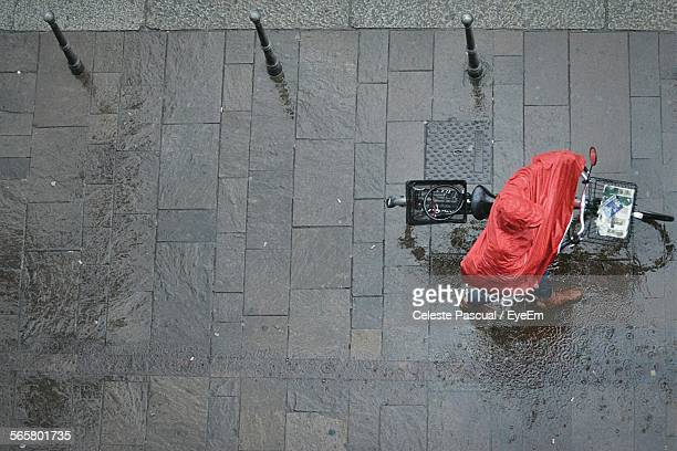 Person Walking With Bicycle During Rain