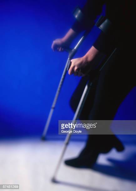 A person walking with crutches