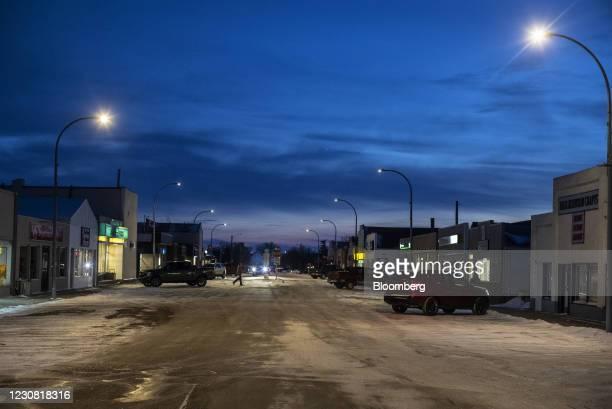 Person walks across the main street in Oyen, Alberta, Canada, on Tuesday, Jan. 26, 2021. U.S. President Joe Biden revokedthe permit forTC Energy...