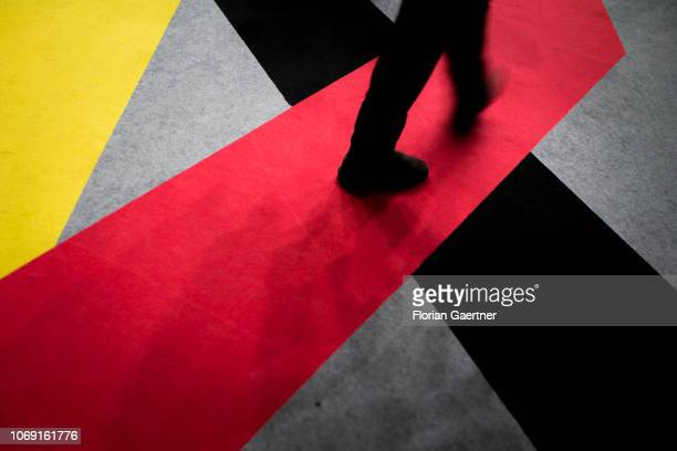 A person walks at the blackredgold carpet at the day before the 31st National Party Conference of the CDU on December 06 2018 in Hamburg Germany The...