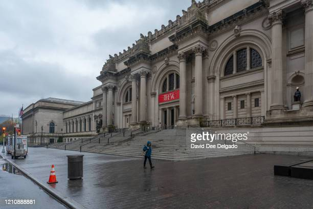 A person walks by a desolate Metropolitan Museum of Art on April 24 in New York City New York State Gov Andrew Cuomo during his daily Covid19 update...