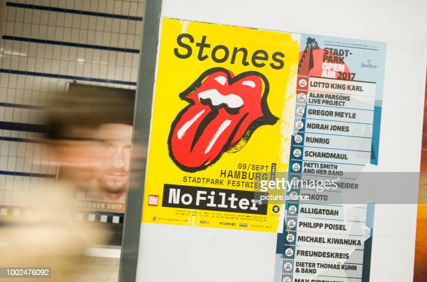 ILLUSTRATION A person walks by a poster for the tour of the Rolling Stones to a wall in Hamburg Germany 12 May 2017 The online presales for the...