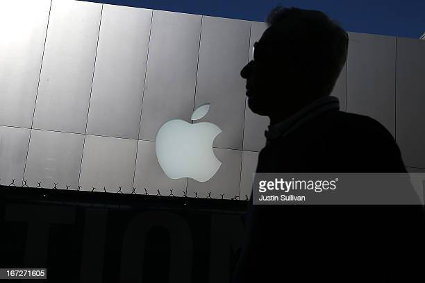 A person walks by an Apple Store on April 23 2013 in San Francisco California Analysts believe that Apple Inc will report their first quarterly loss...