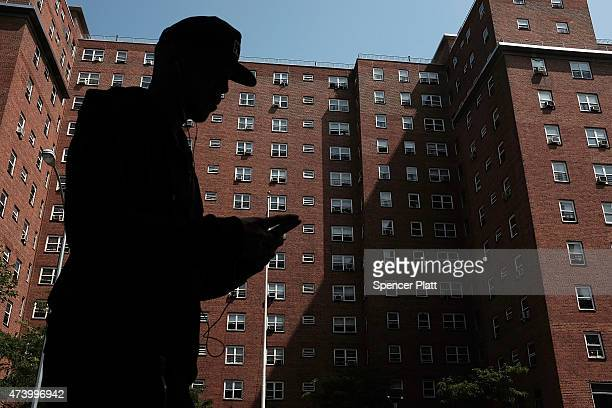 A person walks by an East Harlem public housing complex on May 19 2015 in New York City New York City Mayor Bill de Blasio announced his 10year...
