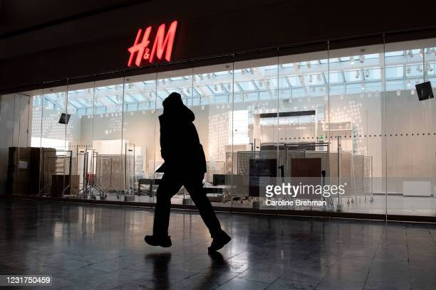 March 16: A person walks by an empty H&M store at Union Station in Washington on Tuesday, March 16, 2021. H&M closed its Union Station location on...