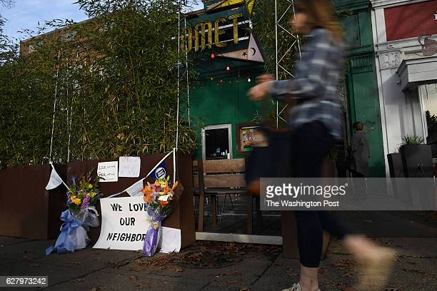 A person walks by Comet Ping Pong on Monday Decmmber 05 2016 in Washington DC A man identified as Edgar Maddison Welch was arrested Sunday after...