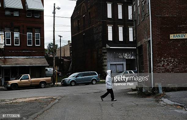 A person walks down a street in downtown on October 24 2016 in East Liverpool Ohio East Liverpool once prosperous from steel mills and a vibrant...