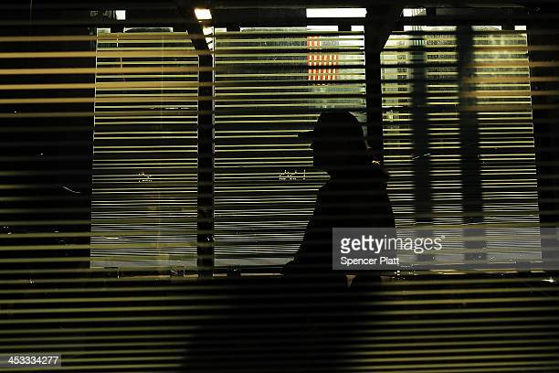 A person walks into the Millenium Hilton on December 3 2013 in New York City In a highly anticipated IPO filing scheduled for next week Hilton...