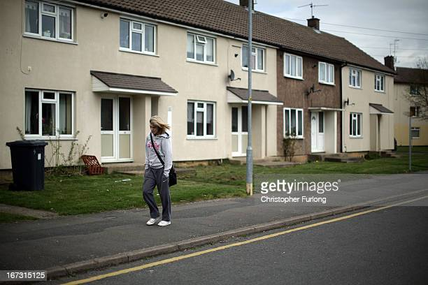 A person walks on the sidewalk in Northamptonshire the youth unemployment capital of Britain on April 24 2013 in Corby England A recent study pin...