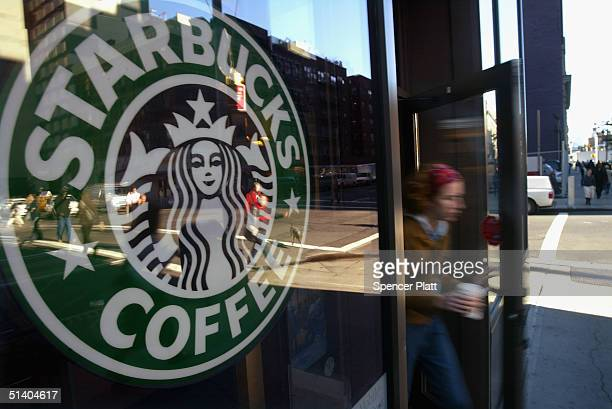 A person walks out of a Starbucks coffee shop October 5 2004 in New York City As coffee bean costs in the US have risen in the past two months the...