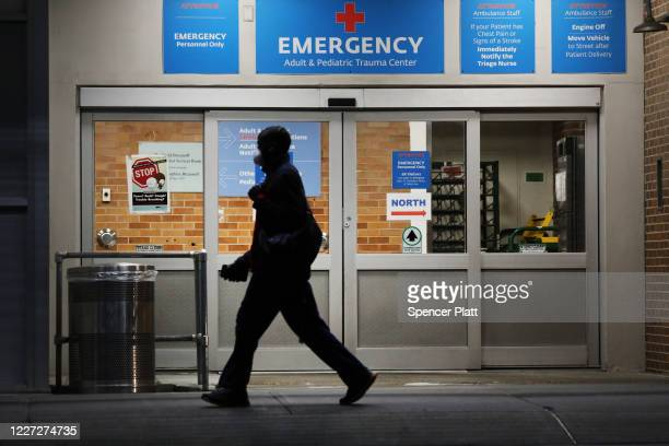 A person walks outside a special coronavirus area at Maimonides Medical Center on May 26 2020 in the Borough Park neighborhood of the Brooklyn...