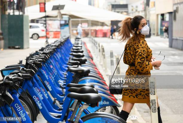 A person walks outside the Madison Square Garden while wearing a protective face mask as the coronavirus continues to spread across the United States...