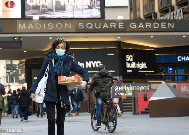 Person walks outside the Madison Square Garden while wearing a protective face mask as the coronavirus continues to spread across the United States...