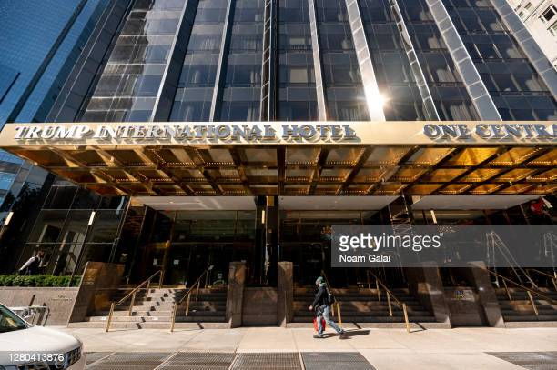 Person walks outside the Trump International Hotel & Tower as the city continues the re-opening efforts following restrictions imposed to slow the...