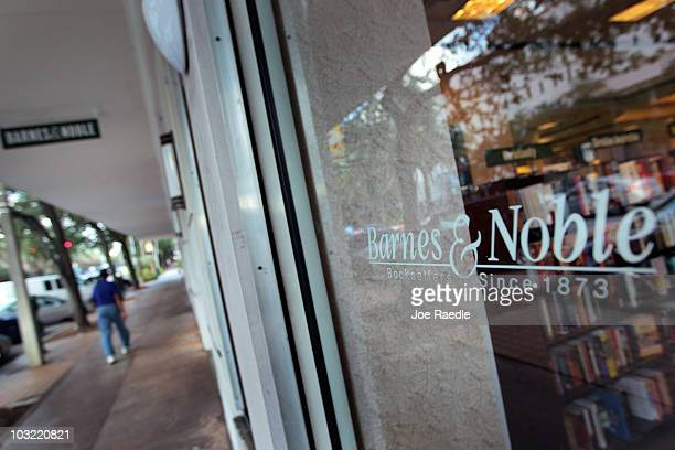 A person walks past a Barnes Noble Booksellers store on August 3 2010 in Coral Gables Florida Today the largest bookstore chain in the US said it is...