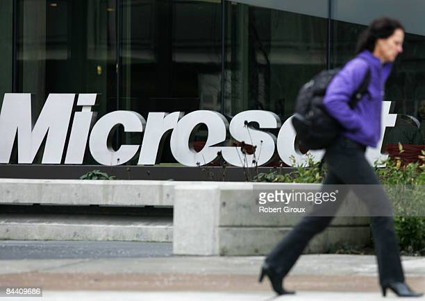 A person walks past a Microsoft sign on January 22 2009 in Redmond Washington The company annouced earlier today they would be laying off up to 5000...